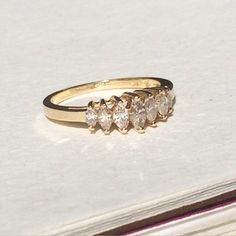 A personal favorite from my Etsy shop https://www.etsy.com/listing/214614761/marquis-diamond-band-gold