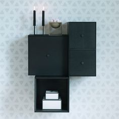 The functional Frame shelf system by By Lassen consist of square boxes in black frames. The Frame modules can be hung on the wall or stand on their own. Frame Shelf, By Lassen, Shelf System, White P, Danish Design, Floating Nightstand, Bathroom Hooks, Shelves, Storage