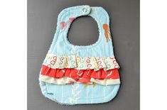 Sew a ruffle baby bib with a free pattern and tutorial from Mary Martha Mama! The bib has an absorbent terry cloth backing. The rows of ruffles make this so pretty for baby girls! Or, if you&#82…
