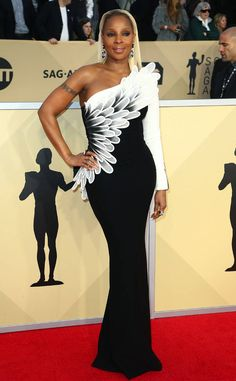 Mary J. Blige from Standout Style Moments at SAG Awards 2018  The transition from the waist up to the shoulder down to the covered arm was thought-out design at its best.