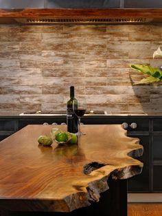 Live edge wood slab kitchen island. Brick wall. George Nakashima inspired