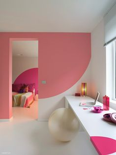 You don't have to paint the entire wall. These opposing curves are perfect for joining the two rooms. Using two different pinks keeps them from blending one into the other yet the two colors are still in the same family. Nicely done!