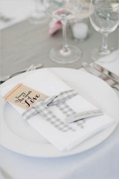 Gingham tied place setting for a sweet southern wedding! (photo by Nadia Meli via Wedding Chicks)