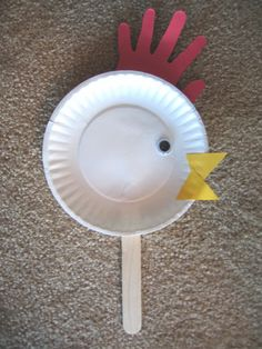 Handprint paper plate chicken.  (May Farm Theme)