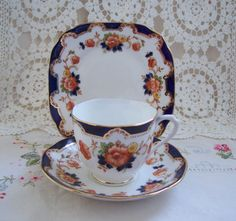 PRETTY-ROYAL-ALBERT-CROWN-CHINA-TRIO-WITH-FLORAL-BLUE-DESIGN-c-Pre-1935