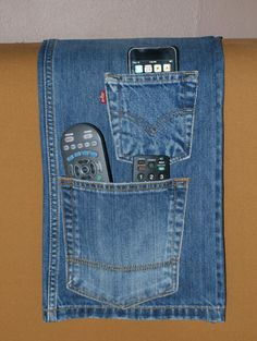 This is a blue jean remote control holder that fits over your headboard or under the mattress. It has two jean pockets that can hold remotes, cell