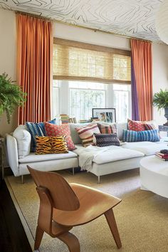 See How Colorful Decorating Ideas Transformed This 100-Year-Old, 2,500-Square-Foot Craftsman | Because sofas can be costly and children can be pretty hard on them, the designer used three modular pieces (as well as an armrest) from Ikea's Söderhamn collection to construct a sectional in the family room, and then she covered it with a large assortment of pillows. #decorideas #homedecor #southernliving