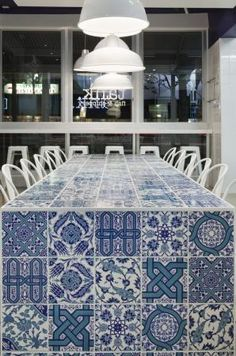 I like this idea for a permanent outdoor table. Would be fun choosing the tiles for the table!