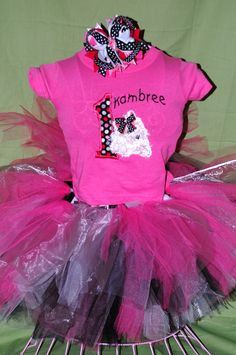 An adorable puppy themed birthday outfit w/ tutu, personalized shirt and matching bow.