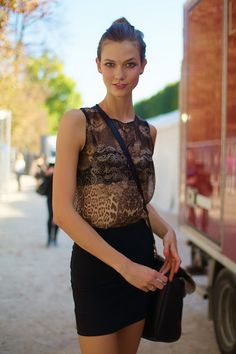 Karlie Kloss rocks a sheer blouse