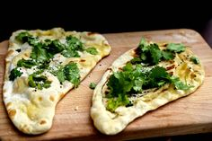 Homemade peshwari naan stuffed with coconut and grated almonds, cooked on a BBQ grill. Butter on top!!