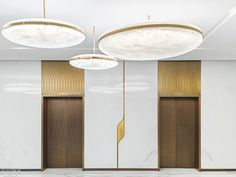 Sybarite Uses Curve Motif to Unify SKP Department Store/Cinema in China Custom fiberglass pendant fixtures enliven the multiplex elevator lobby. Design Hotel, Design Offices, Modern Offices, Lobby Interior, Interior Design, Marble Interior, Interior Ideas, Elevator Lobby Design, Acrylic Chandelier
