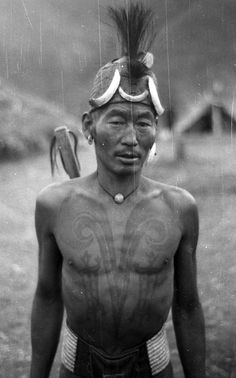 India | Chang Naga man with chest tattoos of a head hunter. Chingmei, Nagaland