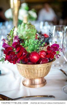 Jewel toned floral arrangement with fruit & greenery | Photographer: Phillip Crous Photography, Venue: Gabrielskloof, Hiring: Function Hiring 4U