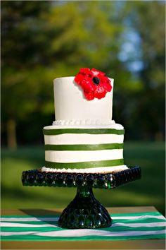 green and white wedding cake with red poppy by second floor bakery #greenandwhitecake #themedwedding #wizardofoz http://www.weddingchicks.com/2014/01/09/wizard-of-oz-wedding-ideas/