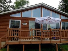 We are a small quiet resort with 13 cottages and three motel units. Located on over 3 acres of beautiful trees and lane ways. Cottage Rentals, Big Fish, Acre, Gazebo, Outdoor Structures, Cabin, Bedroom, House Styles, Beautiful