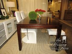 "Transitional style dining table in a dark finish. Just add chairs of your choosing and you have a custom made set. Measures 60""long x 42""wide; (1)18""leaf. Excellent price!"