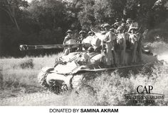 Pakistani soldiers ride on top of a tank during the 1965 war against India.