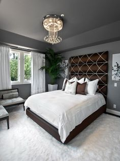 Elegant Bedroom with Grey Walls. Love the headboard portion of the bed, but the rug looks like where I want to sleep.