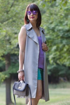 Belted Sleeveless Trench Coat; Turquoise Shorts; Barcelona Cami in purple from Express, Ray Ban Erica Velvet Sunglasses; Tory Burch Wedges, BCBGeneration Noah The Icon Crossbody - more on the blog www.redlipstickoptional.com