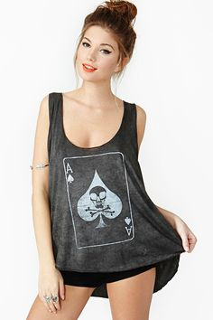 Play For Keeps Tank: Distressed black tank featuring an oversized fit with an ace card and skull graphic. Deep-cut armholes, scoop neckline. Looks rad tossed over a mesh bra and skinnies!