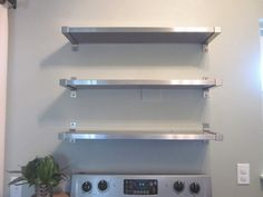 Charming Three Tiers Wall Mounted Kitchen Shelves Over Freestanding Oven Stove Top