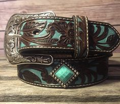 The Floral stamped leather lends to the western appeal of this Ariat belt, but the bling encrusted belt buckle is all about the fashion. The belt features a tooled design with turquoise painted accent