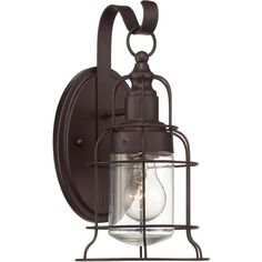 Featuring a seeded glass shade and a vintage-inspired cage design, this timeless outdoor wall lantern casts a stylish glow over your veranda or front doorste...