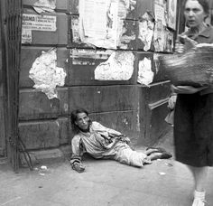 Unknown woman starving, lying in the street of the Warsaw Ghetto, Poland 1941