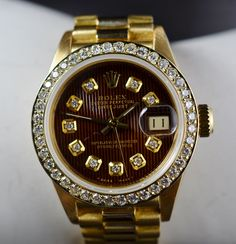 Have the luxury of time: $21,700 Retail solid 18K Gold Rolex Lady Datejust President 26MM Watch Diamond Bezel and Dial Ref # 6917 Circa 1980 http://www.propertyroom.com/l/21700-retail-solid-18k-gold-rolex-lady-datejust-president-26mm-watch-diamond-bezel-and-dial-ref-6917-circa-1980/9758898