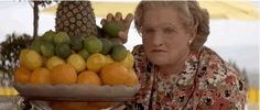 Pin for Later: 16 Moments That Prove Mrs. Doubtfire Will Always Be Hilarious And She Chucks Fruit at Pierce Brosnan For Being All Sexy