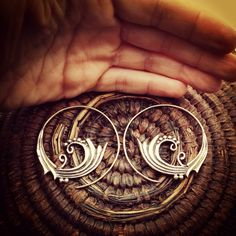Brass spiral hoops  by Talizmani on Etsy, $30.00