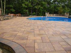 This backyard pool patio was created using Cambridge Pavers.