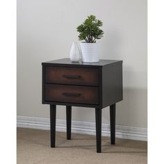 Redecorate your favorite space with this functional, Preston nightstand. This nightstand features a rich black and cherry finish, a durable rubberwood construction and a two-drawer design.