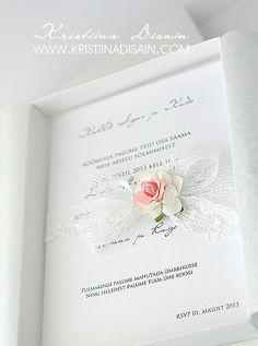 wedding invitation with lace and rose