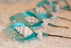 Boutonnieres to go along with Theme Weddings. All handmade your way