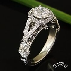 """Custom platinum antique inspired halo mounting with a 1 carat round diamond prong set in the center. Split """"v"""" shape sides with bead set diamonds on either side of the halo. - See more at: http://www.greenlakejewelry.com/gallery/cust_gallery.aspx?ImageID=75892#sthash.W0HDg91Y.dpuf"""