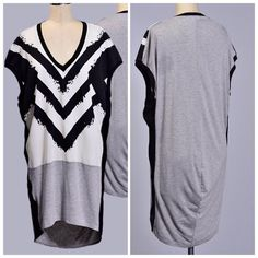 Multi Fabric Top Tunic Chic and unique black, white and grey multi fabric short sleeves tunic top. Match with leggings or jeans, 100% rayon. Tops Tunics