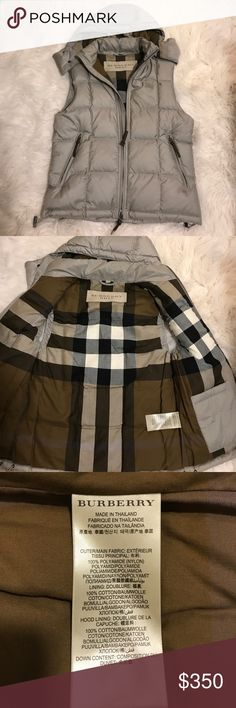 Burberry Men's Vest Burberry Men's vest . Worn maybe 2 or 3 times. In  great condition . Hood zips on and off.  Zipper pulls are leather. Can't find anything wrong with it at all. This is a Men's medium .....a A female could wear this as a large if they wanted. 100% authentic bought in the Oakbrook Illinois store . Burberry Jackets & Coats