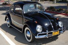 In late 1963, I bought a black 1959 Beetle just like this one. Even had the same kind of old yellow license plates.