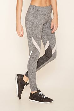 A pair of marled stretch-knit leggings with contrast mesh stripes, reflective tape on the sides, moisture management, and a hidden key pocket.