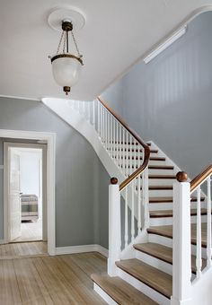 Older wooden cottage turned into a gem of a modern year-round residence Stairs Ideas cotta cottage gem Modern Older Residence turned wooden yearround House Staircase, Staircase Remodel, Living Room Kitchen Paint Ideas, Cottage Stairs, Hallway Colours, Stair Railing Design, Wooden Cottage, Hallway Decorating, Home Reno