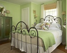 "Beautiful setting for this ""Triple Mountain Top"" antique iron bed design."