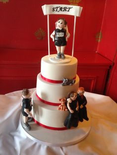 3 tier fun wedding cake for a fab couple who met at the start of a race x