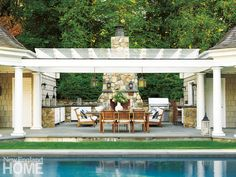 The ultimate outdoor entertaining area with a large outdoor kitchen and dining space. Architecture: Louise Brooks, Brooks & Falotico Associates, Interior Design: Lynn Morgan, Lynn Morgan Design, Photography: Tria Giovan
