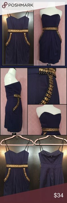 """Navy Strapless dress w/pockets ➖SIZE: 1/2 (no stretch)     ➖Length: 24""""    ➖Bust: 13.5""""    ➖Waist: 11.25""""    ➖Hips: 15.5"""" ➖BRAND. B.Darlin ➖STYLE: strapless sweetheart neckline navy blue dress where the upper half has wiring (like a corset) to hold the shape: The dress has bronze jeweled embellishments as well as pockets!    Add some dainty and delicate jewelry for an added touch of flare! ❌NO TRADE 🙀 B Darlin Dresses Strapless"""