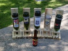 Re-Scape: Robert of Exotic and Domestic Wood Art created wine bottle bird feeders are made from old ship yard pallet wood