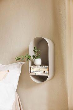 Scandinavian inspired shelving unit in a beige bedroom
