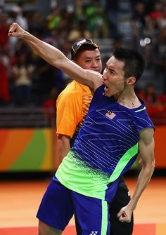 Chong Wei Lee of Malaysia celebrates after defeating Dan Lin of China during the…