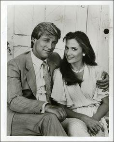 Simon MacCorkindale as 'Greg Reardon' (1984-86) & Ana Alicia as 'Melissa Agretti' (1982-88) in a 1984 publicity photo for Falcon Crest (1981-90, CBS)